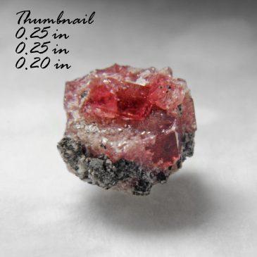 Red Beryl & Bixbyite ? Location: Thomas Range (Topaz Mountain), Juab Co., Utah.    BOX04