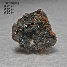Durangite Crystals on Hematite Location: Thomas Range Juab Co. Utah.